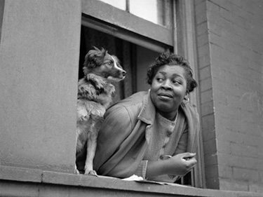 A woman and her dog in Harlem